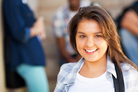Photo pour smiling young middle school girl with friends on background - image libre de droit