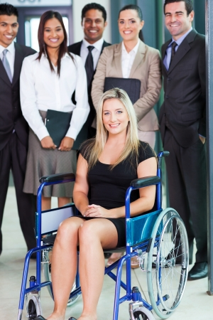 optimistic disabled young businesswoman and team
