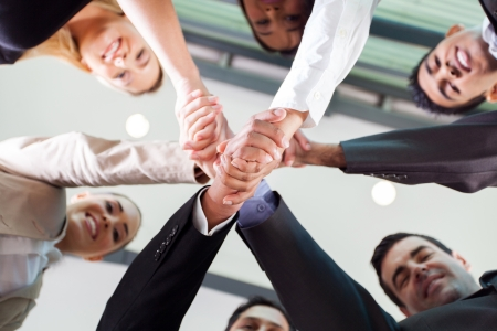 underneath view of group businesspeople handshaking