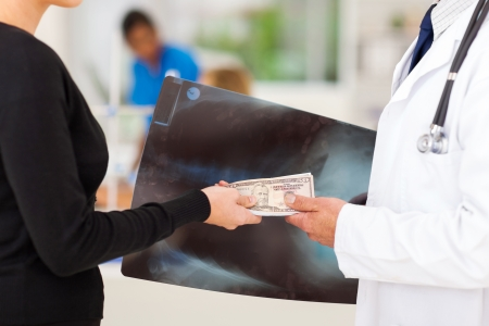 doctor receiving a bribe from medical representative