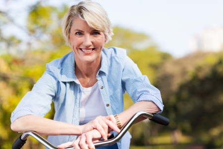 close up portrait of senior woman on a bicycleの写真素材