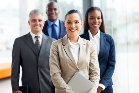Photo pour group of businesspeople standing together in office - image libre de droit