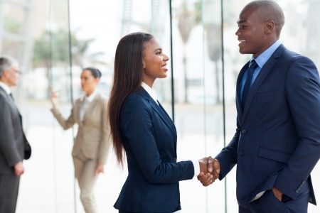 professional african business people handshaking in officeの写真素材