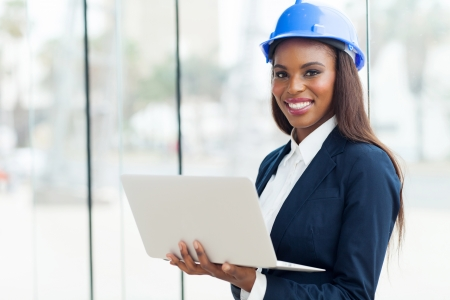 Photo for attractive young african architect using laptop in office - Royalty Free Image