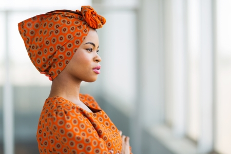 fashionable african businesswoman wearing traditional clothes in office