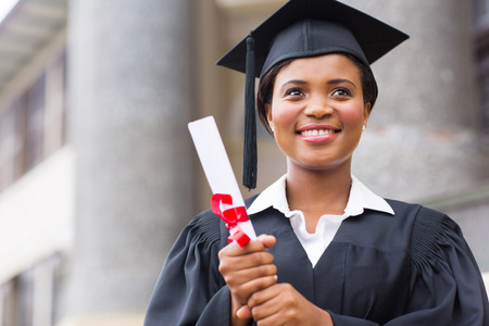 beautiful young afro american graduate holding diploma