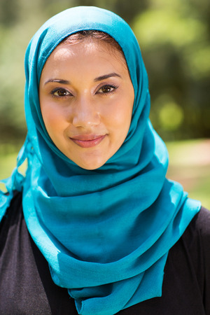 attractive Muslim woman closeup portrait outdoors