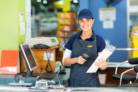 attractive female cashier at hardware store