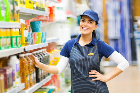 beautiful supermarket saleswoman standing in store