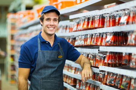 happy hardware store worker looking at the camera