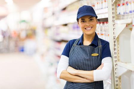 portrait of pretty supermarket shop assistant