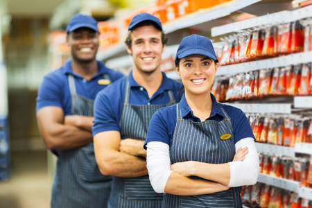 group of smiling hardware store co-workers