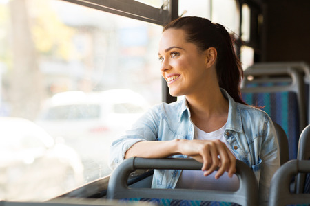 Foto de beautiful young woman taking bus to work - Imagen libre de derechos