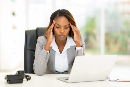 Photo for stressed african businesswoman sitting in office - Royalty Free Image