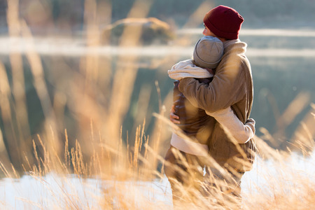 Foto de back view of lovely young couple hugging in winter - Imagen libre de derechos