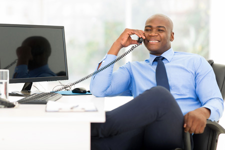 Photo for handsome african american businessman using landline phone - Royalty Free Image