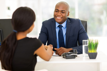 Photo pour successful african american businessman handshaking with client in office - image libre de droit
