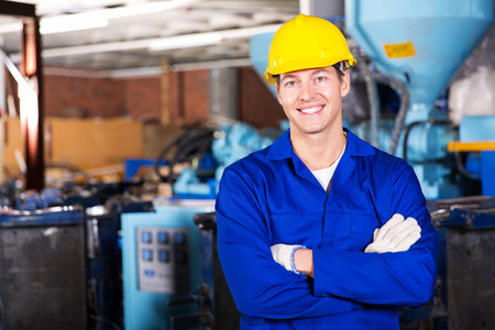 Photo for good looking blue collar worker in factory - Royalty Free Image