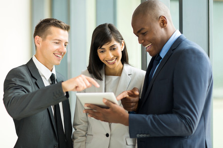 friendly business team using tablet computer in office