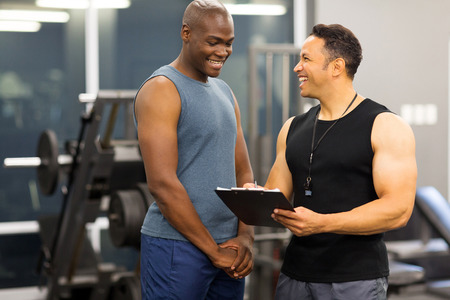 Photo for instructor explaining membership form to client in health club - Royalty Free Image