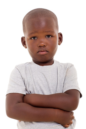 Photo for unhappy little african boy with arms crossed on white background - Royalty Free Image