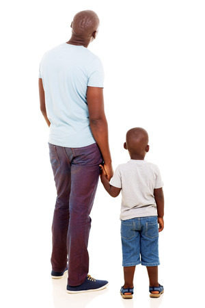 rear view of young african man with his son isolated on white background