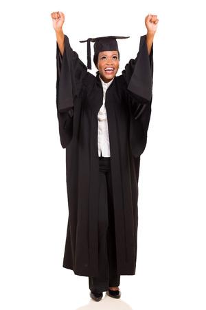 Photo pour joyful african american female university graduate arms up isolated on white - image libre de droit