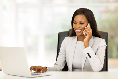 Photo for pretty african american businesswoman using mobile phone - Royalty Free Image