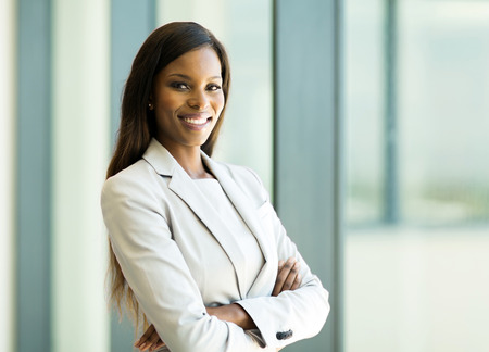 cute african american business woman with arms crossed in office