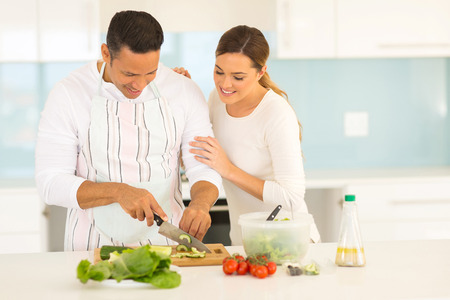 beautiful couple cooking together in home kitchen