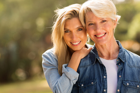 Photo pour mature mother and young daughter looking at the camera - image libre de droit