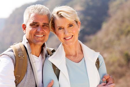 close up portrait of senior hikers couple