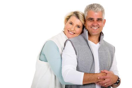 Photo pour pretty middle aged woman hugging her husband - image libre de droit