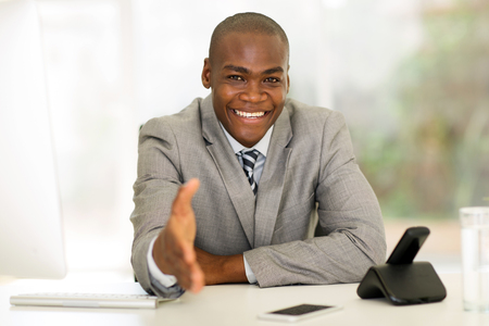 Photo for friendly african businessman offering handshake in office - Royalty Free Image