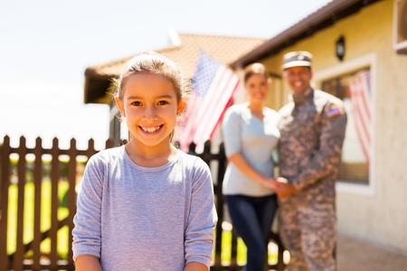 Photo pour adorable little girl standing in front of parents outdoors - image libre de droit