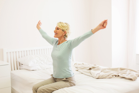 Foto per happy middle aged woman getting up - Immagine Royalty Free