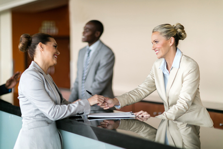 Photo for businessman check in at hotel reception - Royalty Free Image