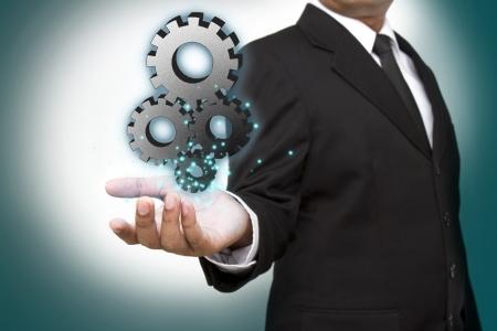 Photo pour Businessman shows gear to success - image libre de droit
