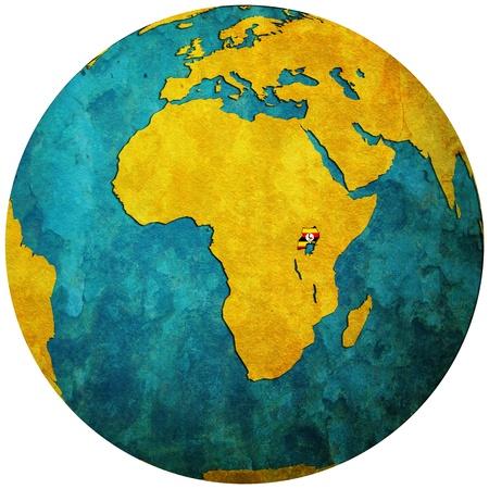 uganda territory with flag on map of globe