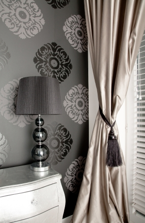Luxurious bedroom in the style of the ancient wall background with an ornament