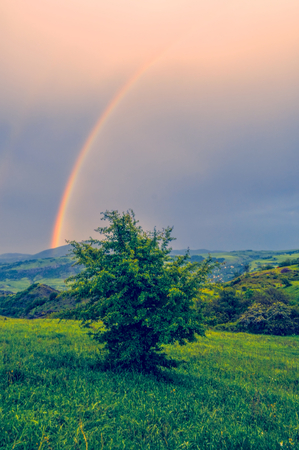 Rainbow over green landscape of mountainous Karabakhの写真素材