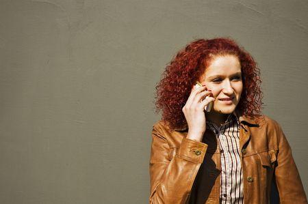 Girl talks by phone