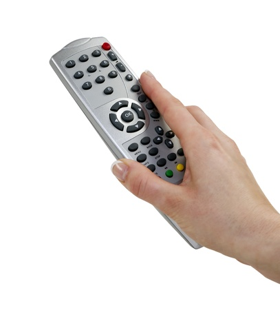 Woman's hand with a remote control from the set-top box with clipping path, isolated on white