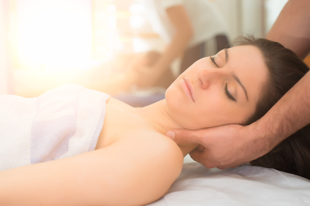 Photo for Therapist massaging the neck of woman In the spa center - Royalty Free Image