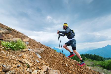 Foto de Climb a mountain with Nordic walking sticks - Imagen libre de derechos