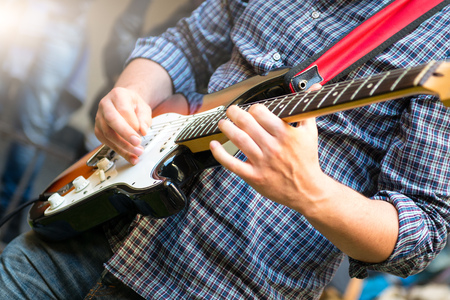 Photo for Electric guitarist of a young group during a show - Royalty Free Image