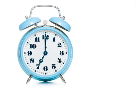 Photo for Classic table alarm clock in green color on a white background - Royalty Free Image