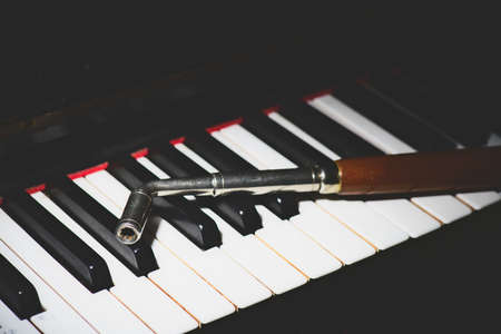 Photo for Piano keyboard with a tuner backed - Royalty Free Image