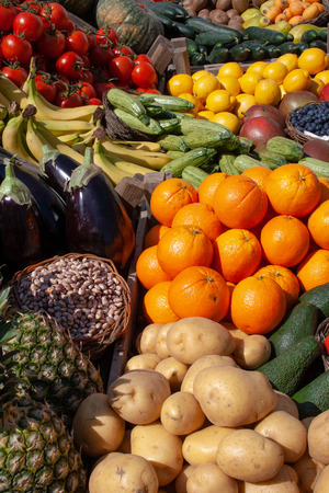 Photo for Beautiful composition of various fresh fruits and vegetables in wooden boxes in a market - Royalty Free Image