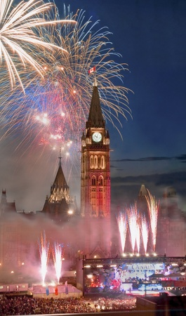 The canadian Parliament during the fireworks display on Canada Day in July